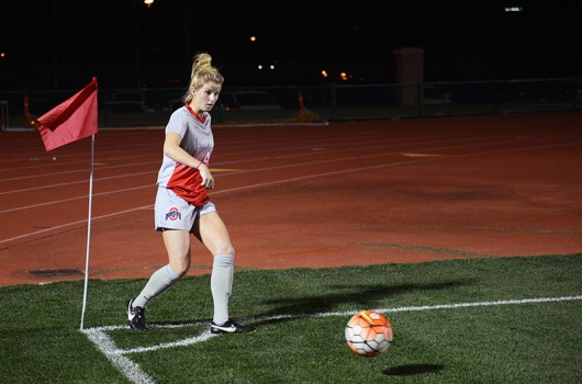 OSU sophomore midfielder Nikki Walts (4) makes a corner kick during a game against Purdue on Oct. 9 at Jesse Owens Memorial Stadium. Credit: Anbo Yao | Lantern Photographer