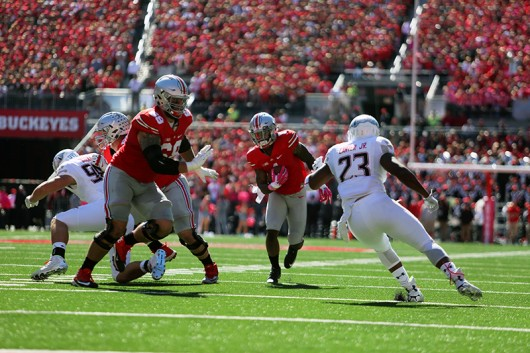 Redshirt senior H-back Braxton Miller (1) carries the ball during a game against Maryland on Oct. 10 at Ohio Stadium. OSU won 49-28. Credit: Samantha Hollingshead / Photo Editor