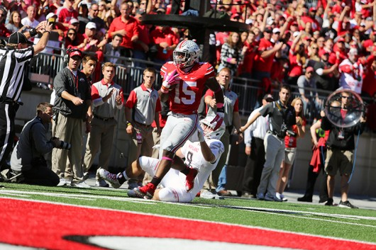 Junior running back Ezekiel Elliott (15) carries the football into the end zone during a game against Maryland on Oct. 10 at Ohio Stadium. OSU won 49-28. Credit: Samantha Hollingshead / Photo Editor