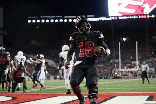 Ohio State redshirt sophomore quarterback J.T. Barrett (16) celebrates after scoring a touchdown on Oct. 20 at Ohio Stadium. OSU beat Penn State 38-10. Credit: Samantha Hollingshead / Photo Editor