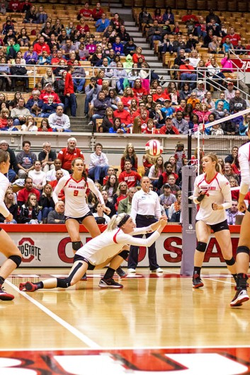 Members of the OSU women's volleyball team during a game against Nebraska on Oct. 3 at St. John Arena. OSU won 3-2. Credit: Ed Momot / For The Lantern
