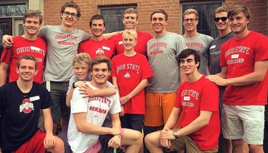 Ohio State swimmers hang out with Alex Davis, a 10-year-old who is in remission from his cancer treatment and has trained with the men's swimming team. Credit: Courtesy of Joey Long