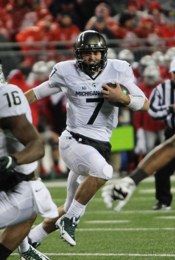 Michigan State quarterback Tyler O'Connor runs with the football in a game against Ohio State on Nov. 21 at Ohio Stadium. OSU lost, 17-14. Credit: Samantha Hollingshead | Photo Editor
