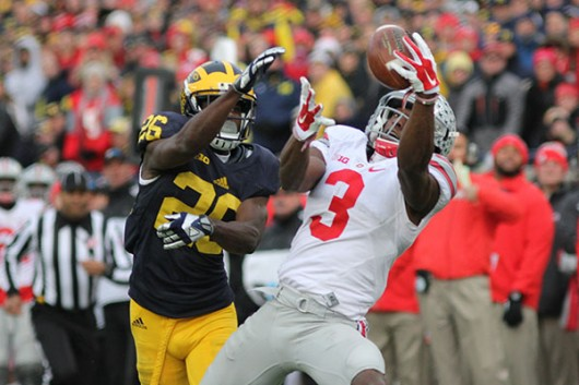 OSU redshirt junior wide receiver Michael Thomas (3) hauls in a pass over Michigan's Jourdan Lewis (26) during a game on Nov. 28 at Michigan Stadium. Credit: Samantha Hollingshead | Photo Editor