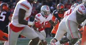 Ohio State junior running back Ezekiel Elliott (15) carries the ball during a game against Illinois on Nov. 14 in Champaign, Illinois. OSU won 28-3. Credit: Samantha Hollingshead | Photo Editor