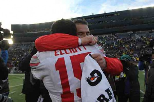 OSU junior running back Ezekiel Elliott (15) embraces coach Urban Meyer following OSU's 42-13 win over Michigan on Nov. 28. Credit: Samantha Hollinshead | Photo Editor