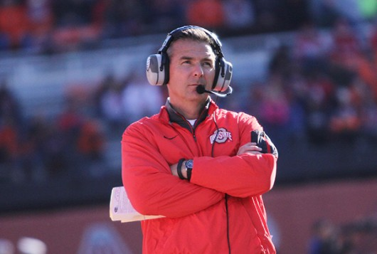 OSU coach Urban Meyer watches a play from the sideline during a game. Credit: Lantern File Photo