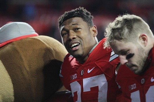 OSU senior linebacker Joshua Perry (37) sings an emotional rendition of Carmen Ohio following the Buckeyes' loss to Michigan State on Nov. 21 at Ohio Stadium. Credit: Samantha Hollingshead | Photo Editor