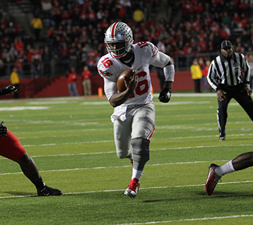 OSU redshirt sophomore quarterback J.T. Barrett (16) runs with the ball during a game against Rutgers on Oct. 24 at High Point Solutions Stadium in Piscataway Township, NJ . OSU won 49-7. Credit: Samantha Hollingshead / Photo Editor