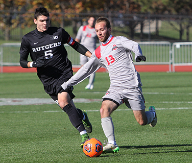 OSU junior forward Christian Soldat (13) dribbles the ball during a game against Rutgers on Nov. 13 at Jesse Owens Memorial Stadium. OSU won 4-0. Credit: Samantha Hollingshead | Photo Editor