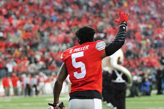 Former OSU H-back Braxton Miller salutes the crowd before his final home game on Nov. 21 against Michigan State. Credit: Lantern File Photo