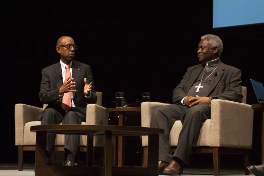"Cardinal Peter Turkson and University President Michael Drake during a ""fireside chat"" in Mershon Auditorium at OSU on Nov. 2. Credit: Kyle Powell 