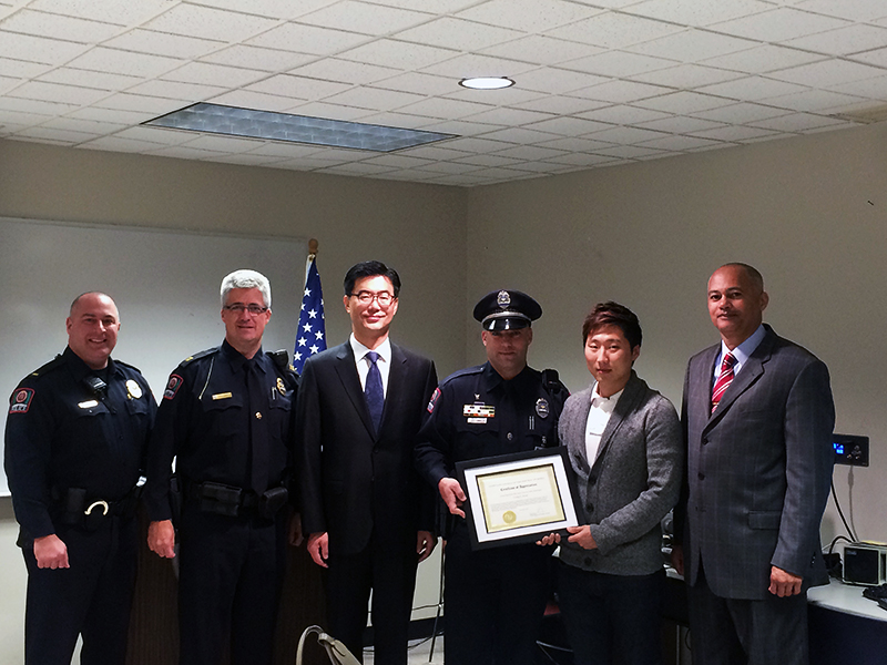 University Police receives certificate of appreciation from the Consulate General of the Republic of Korea. From left to right: Lieutenant Andrew West, Captain David Rose, Deputy Consul General Jae-woong Lee, Officer Cunningham, Wonshin Park and Acting Chief Stone. Credit: Aubrey Cornwell / Lantern reporter