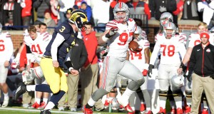OSU junior defensive end Joey Bosa (97) runs with the football after intercepting a pass in a game against Michigan on Nov. 28 at Michigan Stadium. OSU won, 42-13. Credit: Samantha Hollingshead | Photo Editor