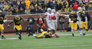 Ohio State junior running back Ezekiel Elliott (15) carries the ball during a game against Michigan on Nov. 28 in Ann Arbor, Michigan. OSU won. Credit: Samantha Hollingshead | Photo Editor
