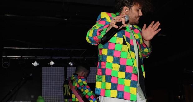 JR JR perform in their neon jackets. Credit: Mason Swires | Lantern reporter