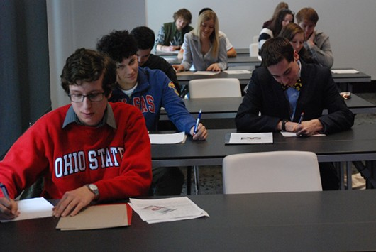 "Paul B. Ellis, a second-year in biology, takes the written trivia test during the closed auditions of ""Jeopardy! College Championships"" on Nov. 21. Credit: Amanda Etchison 