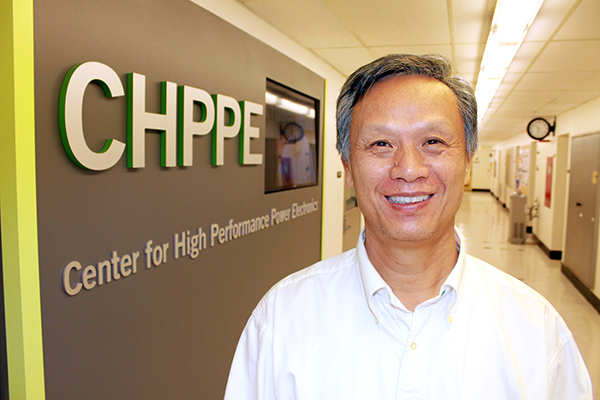 "Longya Xu, electrical and computer engineering professor at the Ohio State, leads the project which was selected by DOE supported energy reduction initiative ""Next Generation Electric Machine"". Credit: Courtesy of Ryan Horns."