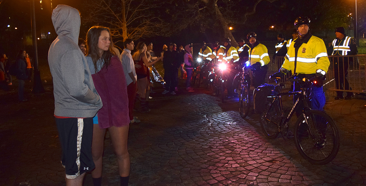 After a medical emergency during the Mirror Lake jump, security officers blocked off access to Mirror Lake with bikes and metal barricades on Nov. 25. Credit: Robert Scarpinito | Copy Chief