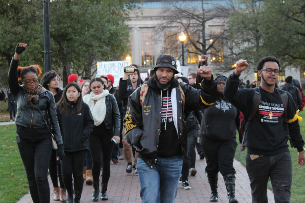 "Ohio State students and protesters marched from the Oval to the Ohio Union on Friday, during the ""#OSU2MIZZOU: Racism Lives Here"" event. Credit: Michael Huson / Campus Editor"