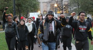 """Ohio State students and protesters marched from the Oval to the Ohio Union on Friday, during the """"#OSU2MIZZOU: Racism Lives Here"""" event. Credit: Michael Huson / Campus Editor"""