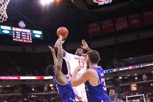OSU freshman JaQuan Lyle (13) takes a shot over two UT Arlington players during a game on Nov. 20 at the Schottenstein Center in Columbus, Ohio. OSU lost 73-68. Credit: Hanna Roth | Lantern Photographer