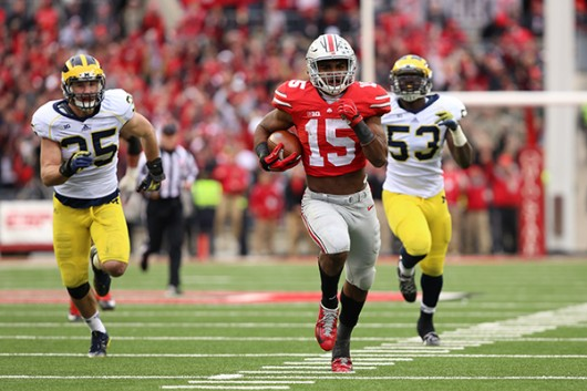Then sophomore running back Ezekiel Elliott (15) carries the ball during a game against Michigan on Nov. 29 at Ohio Stadium. OSU won, 42-28. Credit: Lantern File Photo