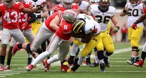 Then-freshman linebacker Raekwon McMillan (5) tackles Michigan then-sophomore running back De'Veon Smith (4) during a Nov. 29 game at Ohio Stadium. OSU won, 42-28. Credit: Lantern File Photo