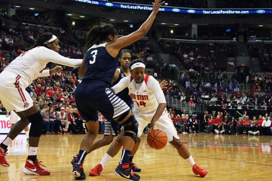 OSU Sophomore Guard Ameryst Alston (14) during a game against UConn on Nov. 16.  OSU lost 100-56. Credit: Ian Bailey | Lantern Reporter