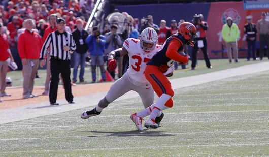 OSU senior linebacker Joshua Perry (37) attempts to tackle Illinois wide receiver Desmond Cain (86) during a game on Nov. 14 at Memorial Stadium in Champaign, Illinois. OSU won 28-3. Credit: Samantha Hollingshead | Photo Editor