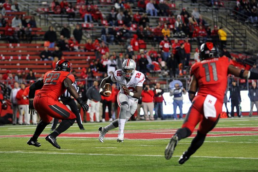OSU redshirt junior quarterback Cardale Jones (12) runs with the ball during a game against Rutgers on Oct. 24 at High Point Solutions Stadium in Piscataway Township, NJ . OSU won 49-7. Credit: Samantha Hollingshead | Photo Editor
