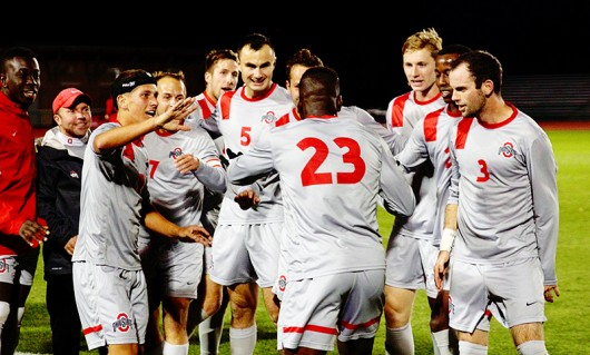 Members of the OSU men's soccer team celebrate after scoring a goal against Maryland during a game at Jesse Owens Memorial Stadium on Oct. 31. OSU won 1-0. Photo Credit: Amanda Etchison | Miller Reporter