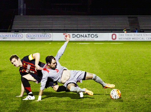Maryland midfielder Mael Corboz (8) and OSU senior midfielder Kyle Culbertson (3) struggle over the ball during a game at Jesse Owens Memorial Stadium on Oct. 31, 2015. OSU won 1-0. Credit: Amanda Etchison | Editor in Chief