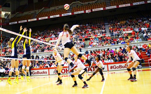 Members of the OSU women's volleyball team during a game against Michigan on Nov. 14 at St. John Arena. OSU lost 3-0. Credit: Lantern file photo