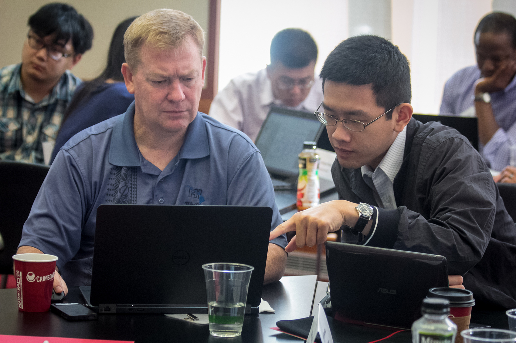 John Bair (left), a mentor of the engineering team, and Bert Liu, student lab member of the engineering team, working at the I-Corps@Ohio Program. Photo courtesy of I-Corps@Ohio.