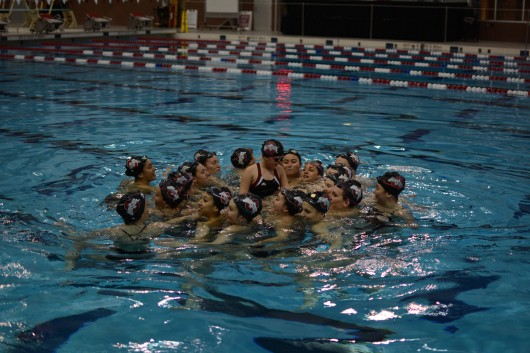 Members of the OSU synchronized swimming team gather around their newest teammate on Nov. 19. Credit: Kevin Stankiewicz | Assistant Sports Editor