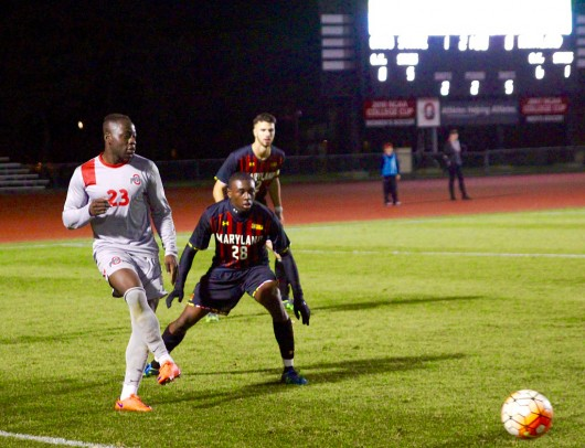 Ohio State forward Yaw Amankwa (23) sends a ball past Maryland defender Chris Odoi-Atsem (28) during a game at Jesse Owens Memorial Stadium on Oct. 31, 2015. Credit: Lantern File Photo