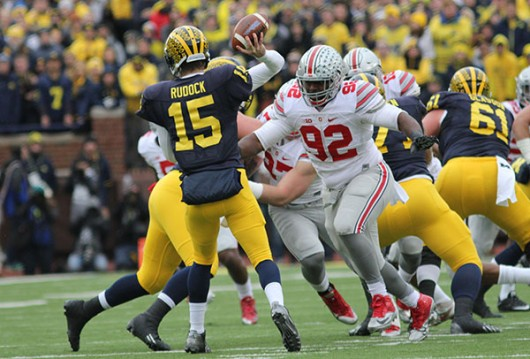 Former OSU defensive lineman Adolphus Washington (92) pressures Michigan quarterback Jake Rudock on Nov. 28. Credit: Samantha Hollingshead | Photo Editor