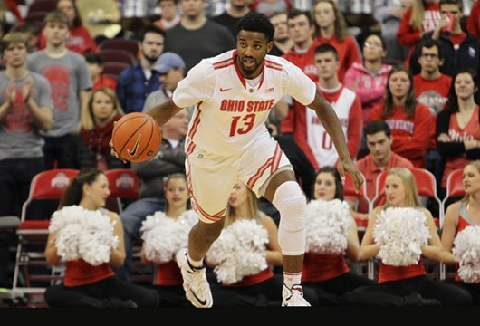 OSU freshman guard JaQuan Lyle (13) dribbles the ball up the court in a game against Air Force on Dec. 8 in Columbus. OSU won, 74-50. Credit: Samantha Hollingshead |Photo Editor