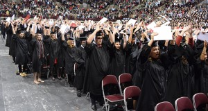 """Ohio State graduates sing the conclusion of their alma mater, """"Carmen Ohio,"""" to conclude the 2015 Autumn Commencement on Dec. 20."""