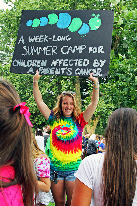 Aliesha Robinson, third-year in middle childhood education, holds up a sign to bring awareness to Camp Kesem during Ohio State's involvement fair on August 23. Photo Credit: Samantha Hollingshead / Photo Editor