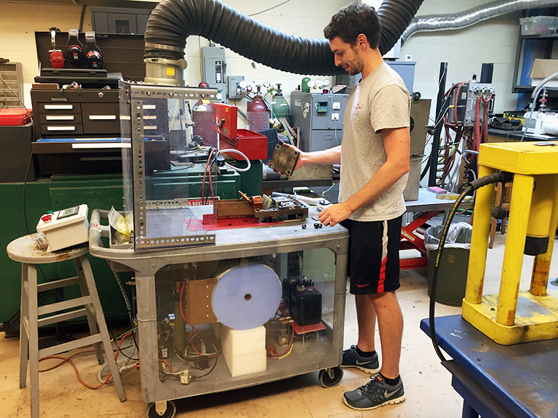 Scott Wright, fifth-year in materials science engineering demonstrates how the new welding technique is made. Credit: Lauren Holley / Lantern reporter