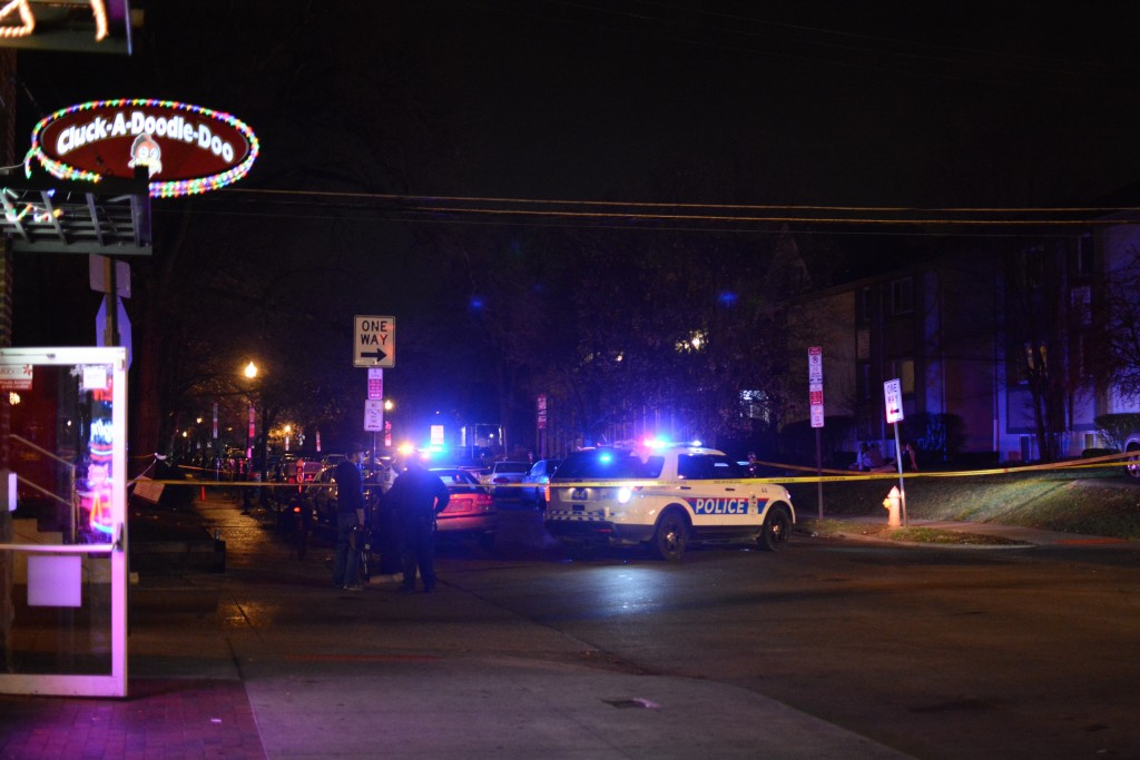 Two police vehicles block access to East 12th Avenue, where an alleged stabbing took place early Sunday morning. Credit: Kevin Stankiewicz | Assistant Sports Editor