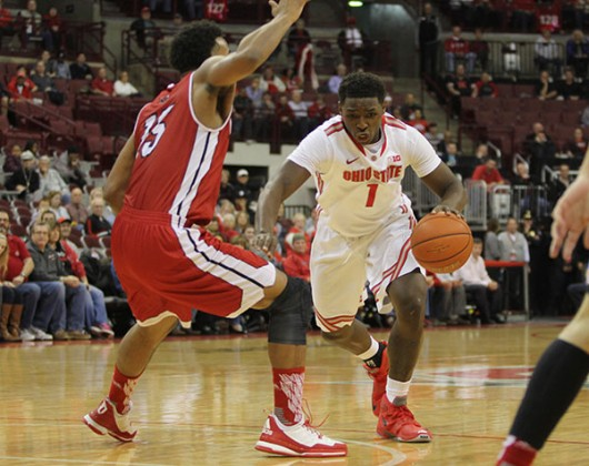 OSU sophomore forward Jae'Sean Tate (1) dribbles the ball during a game against Northern Illinois on Dec. 16 at the Schottenstein Center. Credit: Samantha Hollingshead | Photo Editor