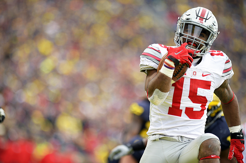 OSU junior running back Ezekiel Elliott (15) runs with the ball to the end zone during a game against Michigan on Nov. 28 at Michigan Stadium in Ann Arbor, Michigan. OSU won 42-13. Credit: Muyao Shen | Assistant Photo Editor