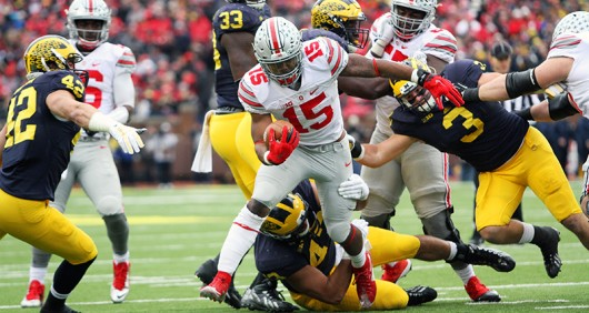 Former OSU running back Ezekiel Elliott breaks a tackle at Michigan on Nov. 28. Credit: Samantha Hollingshead | Photo Editor