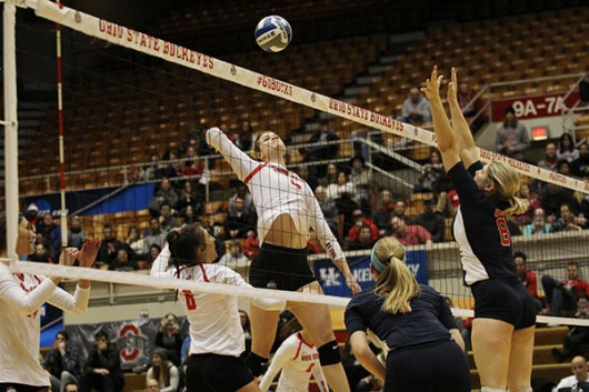 OSU senior middle blocker Andrea Kacsits (4) during a game against Robert Morris in the NCAA tournament on Dec. 4 at St. John Arena. OSU won/lost. Credit: Samantha Hollingshead | Photo Editor
