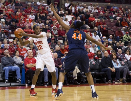 OSU forward Alexa Hart (22) looks for space around defending Virginia Cavaliers forward Sydney Umeri (44) on Dec. 21 at the Schottenstein Center. Photo Credit: Greg Bartram | USA TODAY Sports