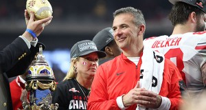 OSU coach Urban Meyer flashes a grin while on the podium celebrating the Buckeyes' 44-28 victory over Notre in the Fiesta Bowl on Jan. 1. Credit: Samantha Hollingshead | Photo Editor