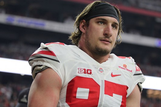 OSU junior defensive end Joey Bosa walks off the field after being ejected in the first quarter of the Fiesta Bowl on Jan. 1. OSU won, 44-28. Credit: Samantha Hollingshead | Photo Editor